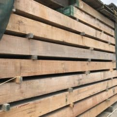 Beams stacked in our yard